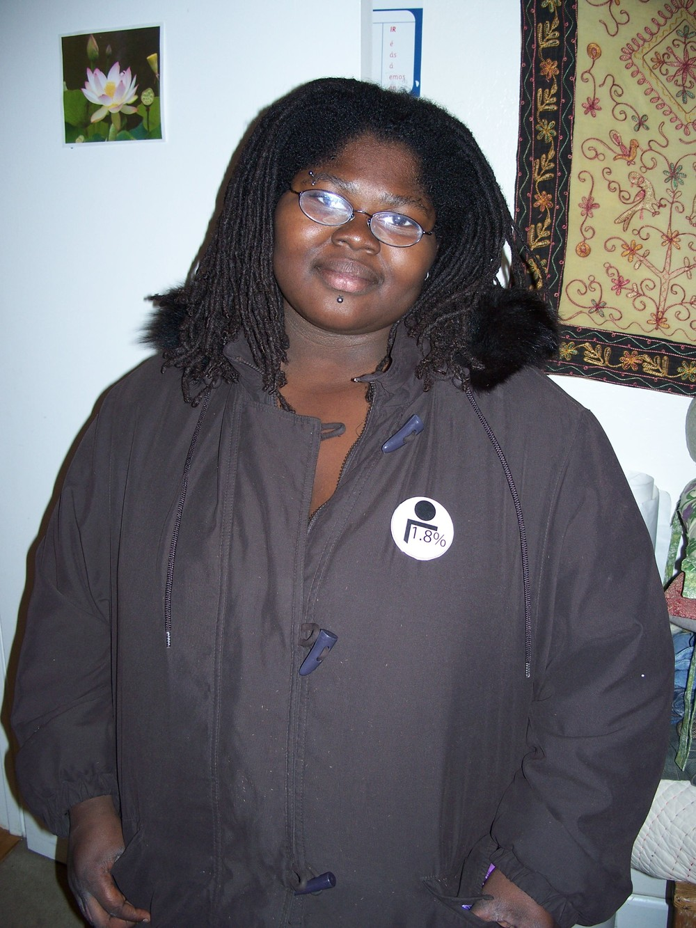"CCA student, Marnika Shelton, wearing ""1.8%"" button"