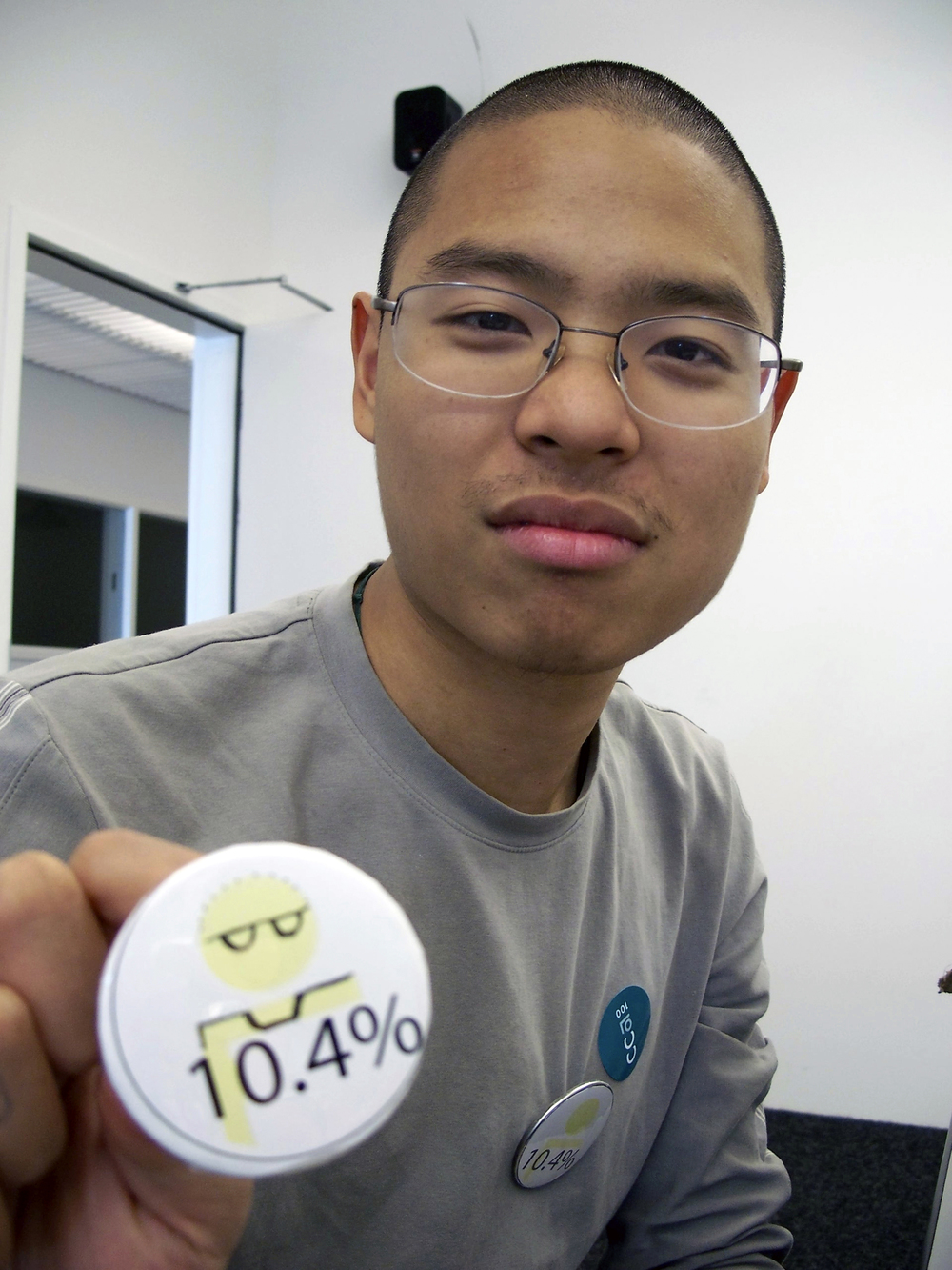 "CCA architecture student posing with modified ""10.4%"" button"