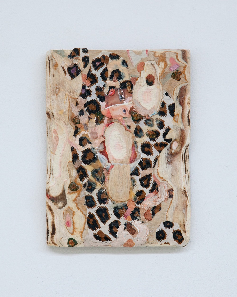 Piebald , 2015, oil, plastic, and skin whitening soap box on carved wood, 7 x 5 inches
