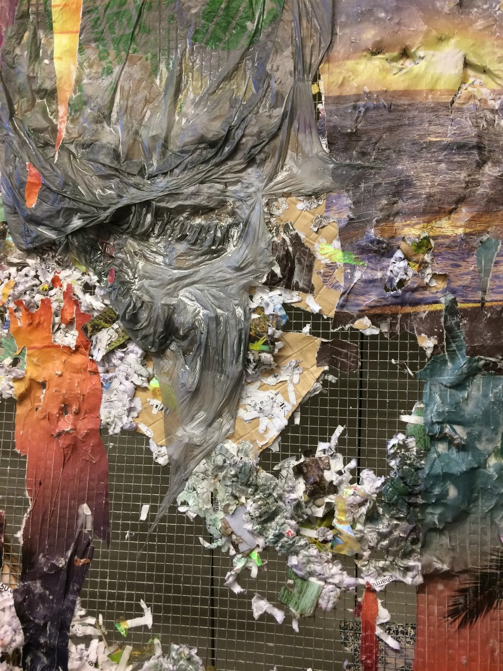 How Do I Raise the Ground Where I Land  (detail) ,  2017, Medical records, Banig print wallpaper, puzzle pieces, nature calendars, Dollar Tree and Subway bag, acrylic and oil on chicken wire and wood, 38 x 60 x 4 inches