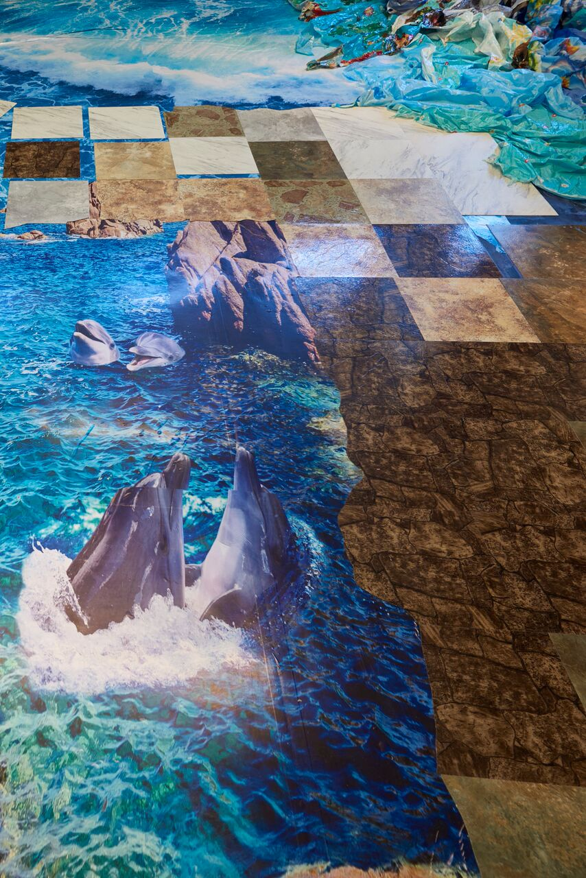 Pieceable Kingdom, 2018 MAD Museum Van Lier Fellow Focus exhibition. Materials include Acrylic paint, faux stone tiles, tropical island floor vinyl, holiday-themed plastic tablecloths, and plastic shopping bags manufactured in Asia and purchased in dollar stores around New York City.  Image by Jacob Schrueger.