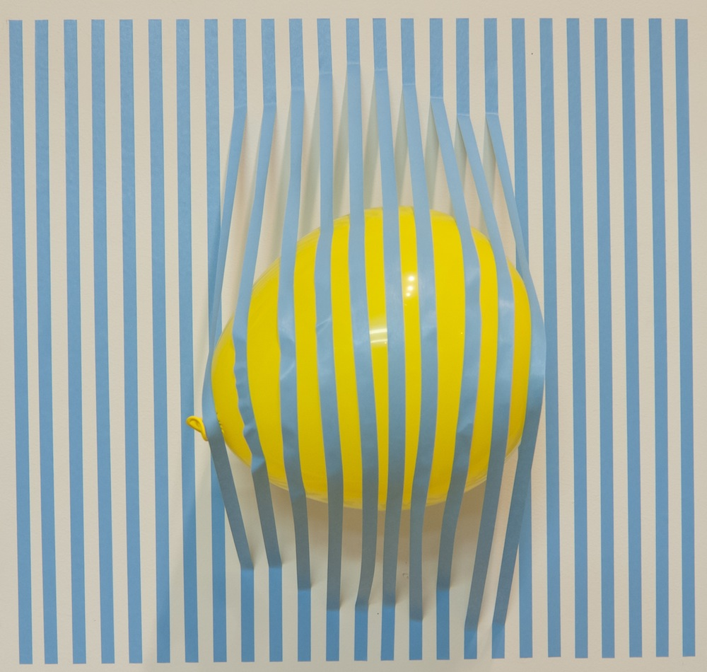 "Unorganized System   2012  tape, balloon  24"" x 24"" x 12"""