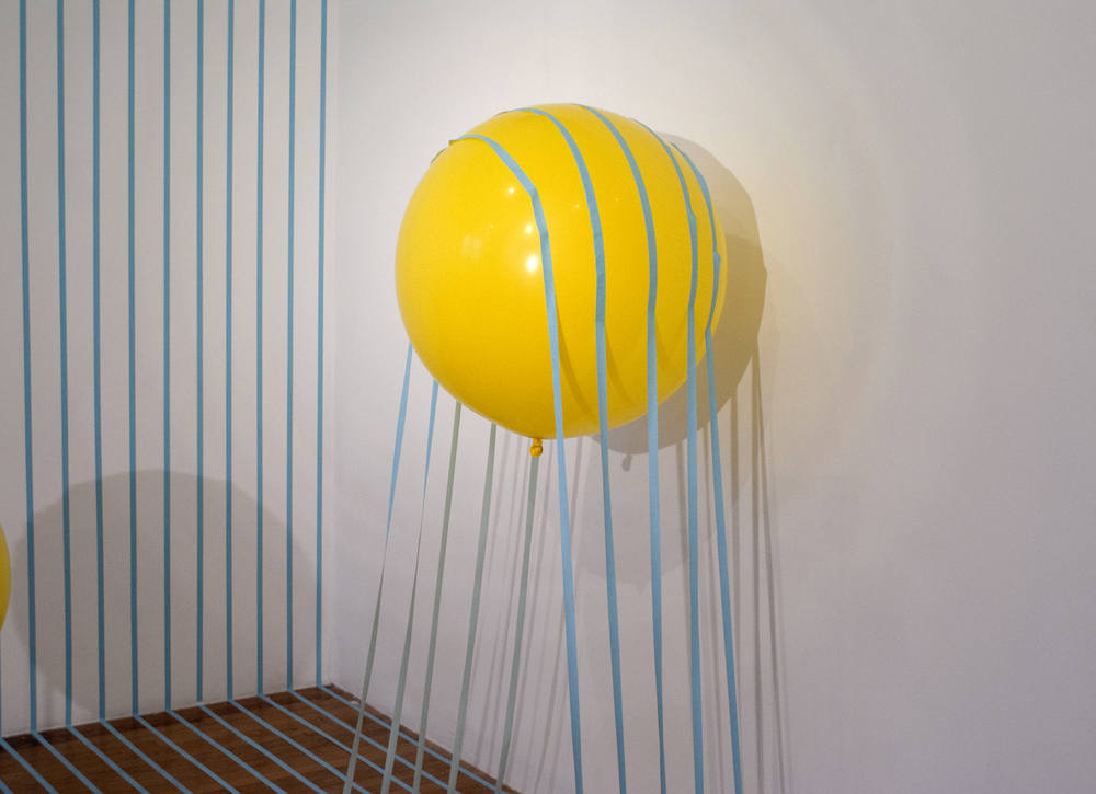"Buoyant Loss   2014  artist tape, balloon, and helium  120""x180""x120"""