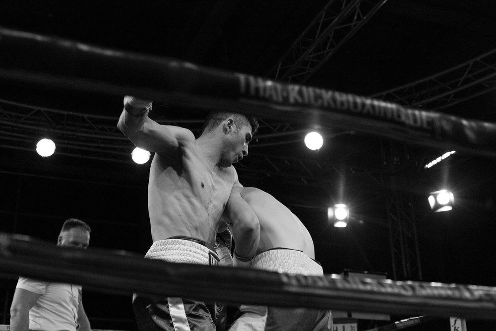Naghi Shakeri prepares a body blow against Victor Ionascu in their debut fight.