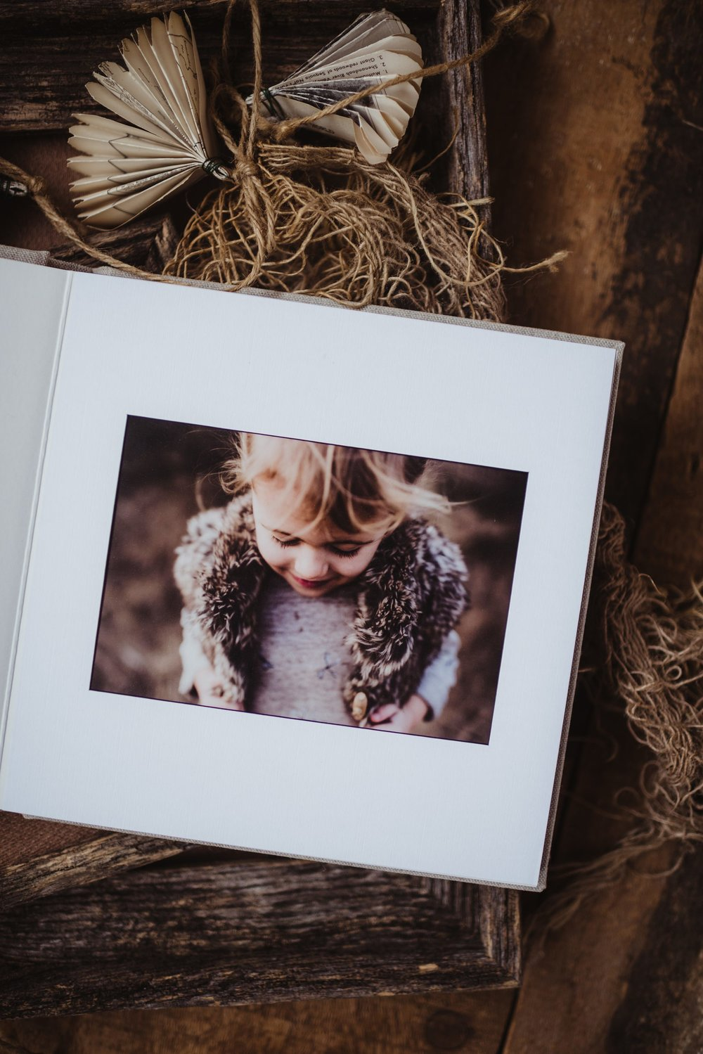*Perfect album for Family, Newborn, and Engagement Sessions . Professionally mounted and artfully bordered. 8x8 album comes in 10-page or 20-page or 30-pages. Beautiful Navy fabric cover. Each page is adorned with a single 5x7 image.    Matted Album Pricing    10 page | $350  20 page | $400  30 page | $450