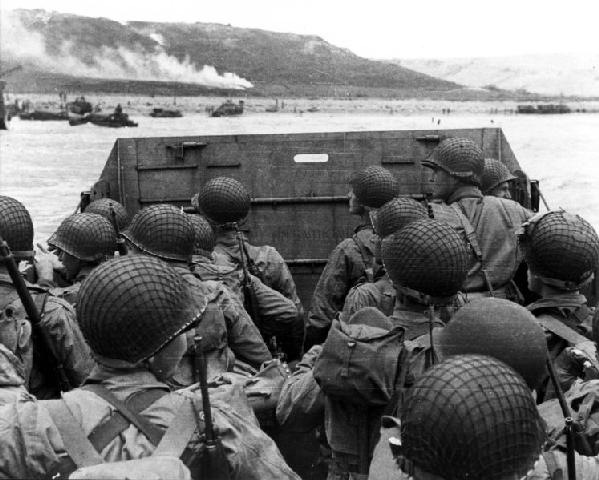Troops in an LCVP landing craft approaching