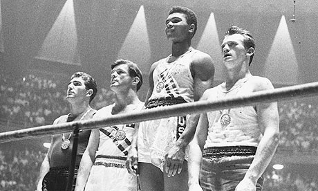Muhammed Ali donning the gold medal at the 1960 summer Olympics