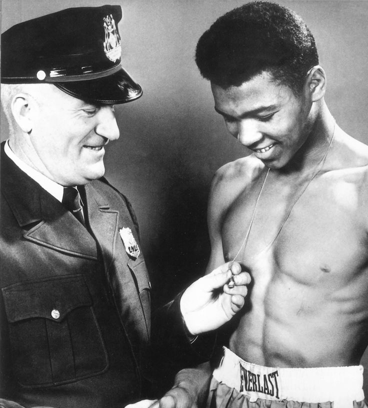 A young Cassius Marcellus Clay with Joe Elsby Martin the Louisville Kentucky police officer who taught him how to box.