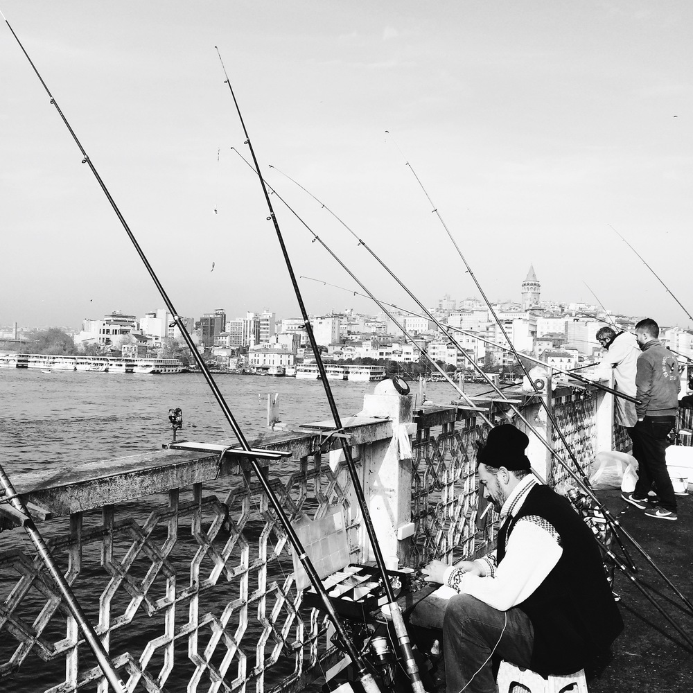 People line up all along the Galata bridge to fish in the waters. As brilliant a view into the life of people here as can be. These are not fishermen but just people eking out a living any way they can. They are not fishing for their own plates but to sell to the overprices fish restaurants below the bridge. Anyone can fish here as the water abound with fish. Yet, I am not sure I would want to eat them given the pollution into the water from the steamers and boats docked all along the edge.