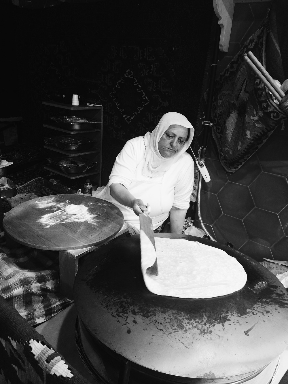 A lady making the thin crepe like bread for Gozleme in a window of a restaurant. I am not kidding. There are many establishments which display ladies making these fresh everyday much like the dumpling making women in Chinatown. Life is hard in the city, and, being an European one, expensive. It often shows in the expressions of people here, who are doing what they can to make ends meet.
