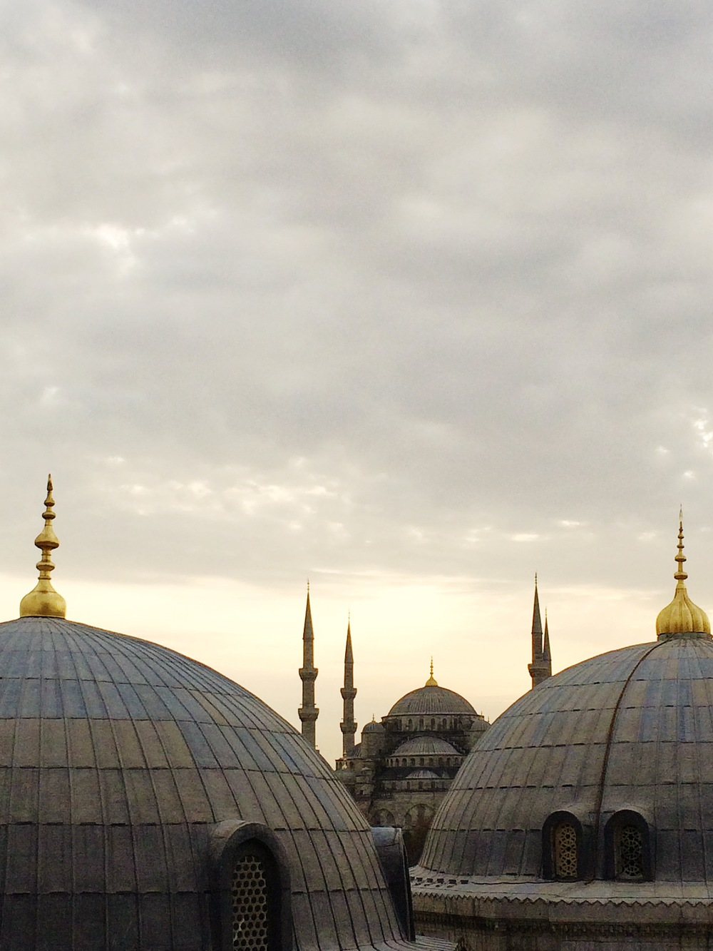 View of the Blue Mosque taken from inside the Aya Sophia. They look across at each other. It is a stunning sight at dusk