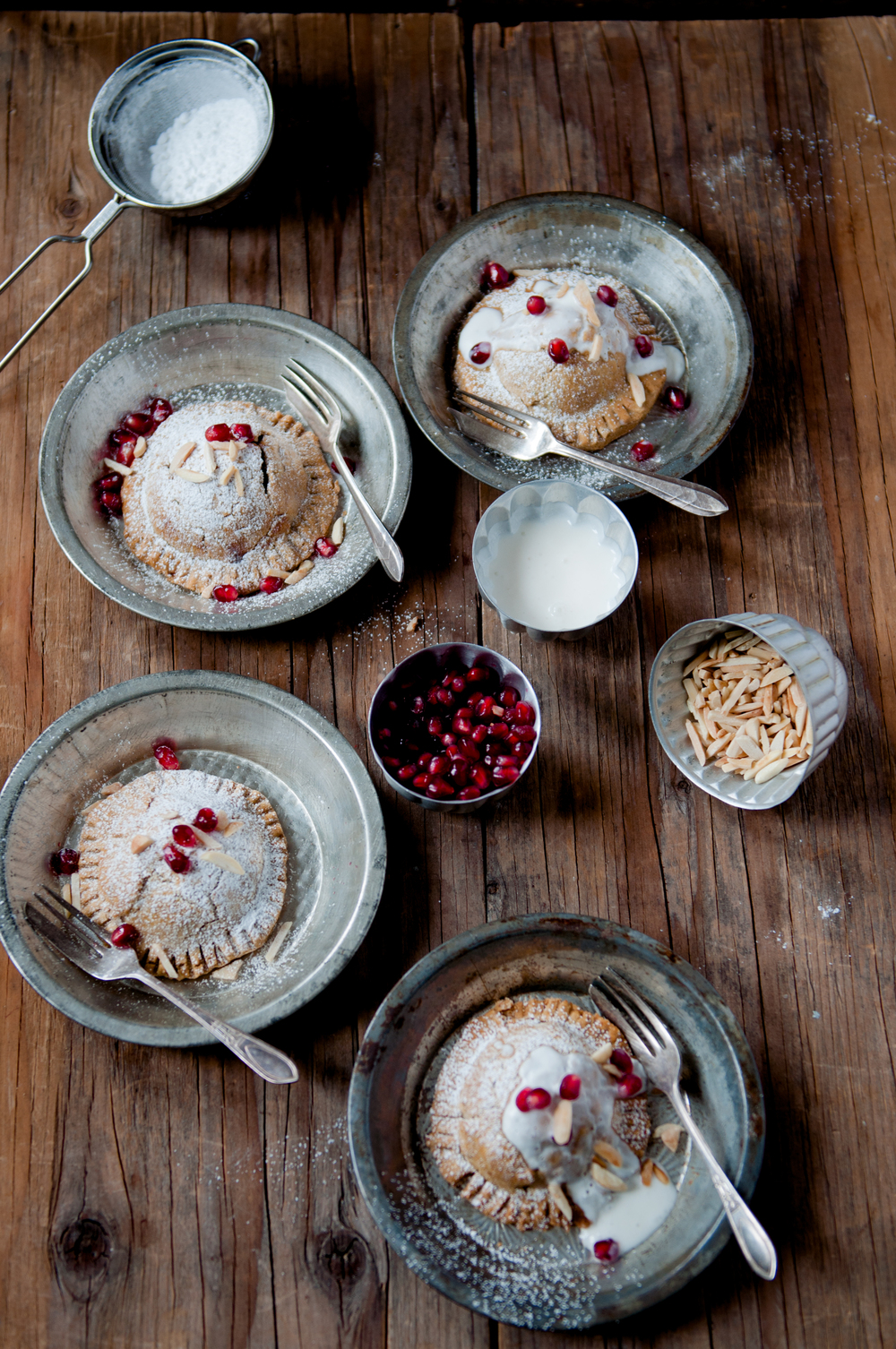 Gluten Free pockets with raw sugar and cardamom roasted Asian pears finished with sweetened yogurt and pomegranate.