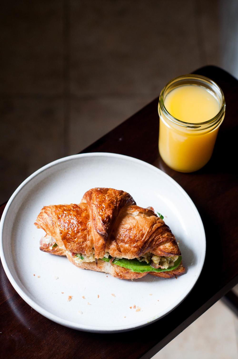 Lamb proscuitto scrambled egg croissant sandwich