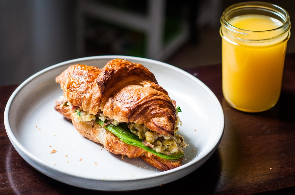 Lamb proscuitto, egg and avocado sandwich in croissant