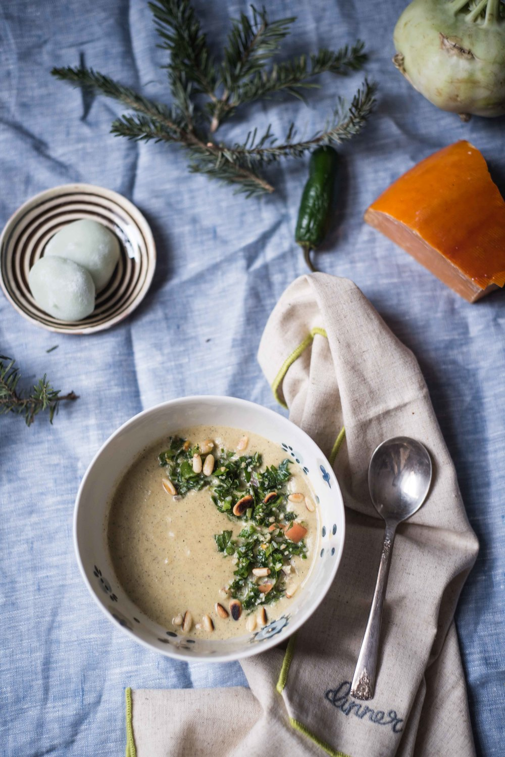 Roast Poblano, Jalapeno, Celeriac and Rutabaga Soup with cream and caramely Dutch cheese.