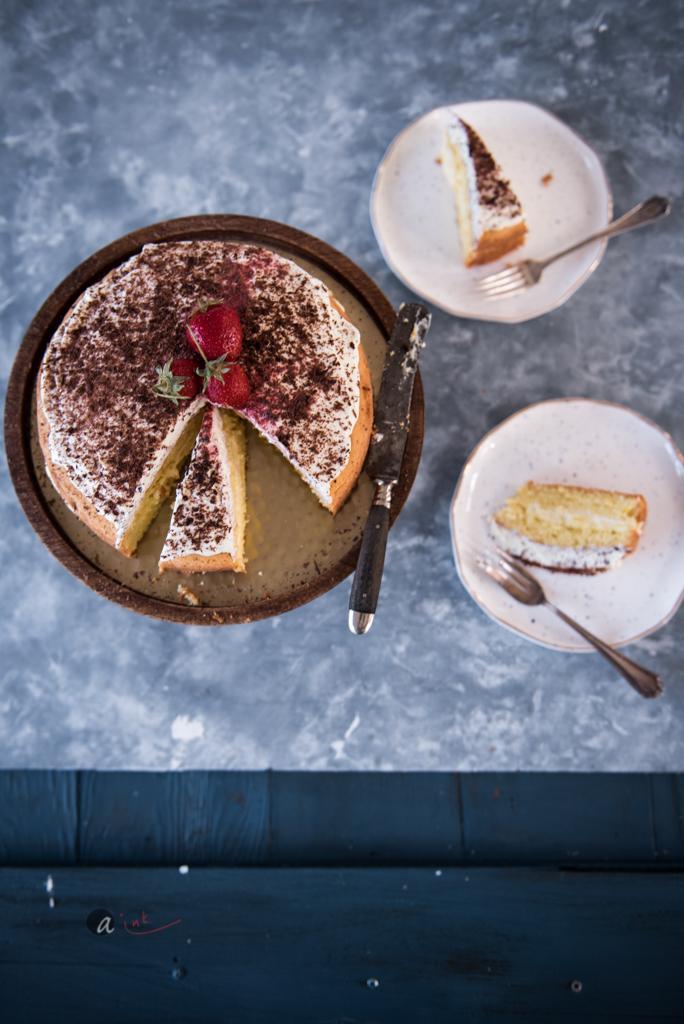 lemon-victoria-sponge-layer-cake-sliced.jpg