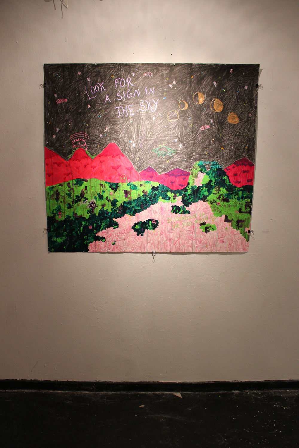 A cryptic mixed media piece by Jessica Butler '14 dominated one of the walls at the exhibit. Photo by Lexie Brown '17
