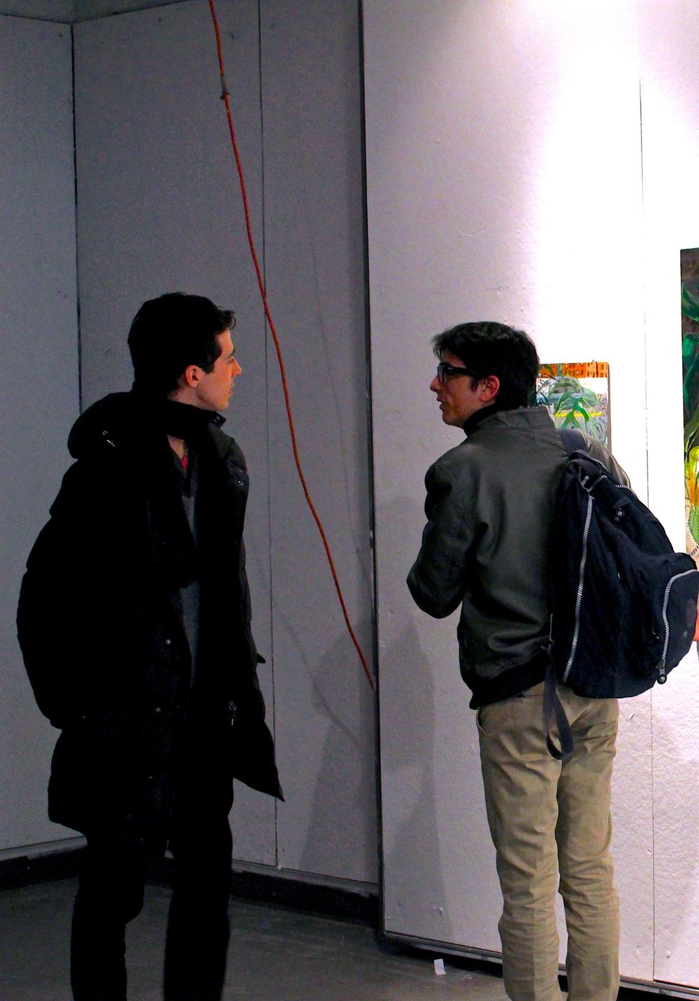 Alexis de Chaunac '14 and Roberto Rochin '17 examine Kaia Zimmerman's work