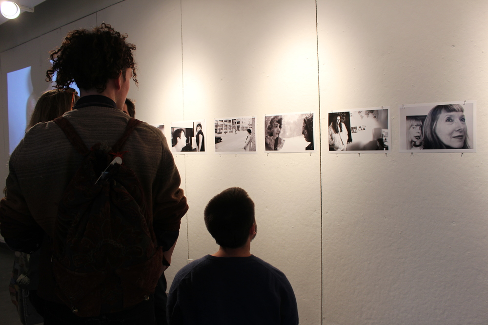 Students view the photographs of Keira Castellitto '16