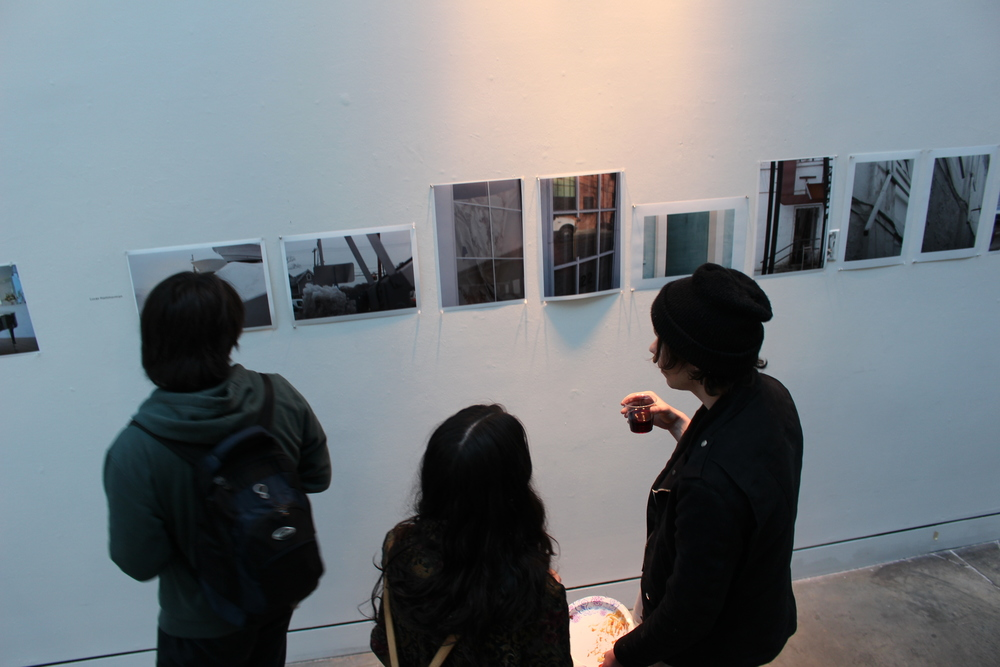Students view photographs by Luke Hammerman '14