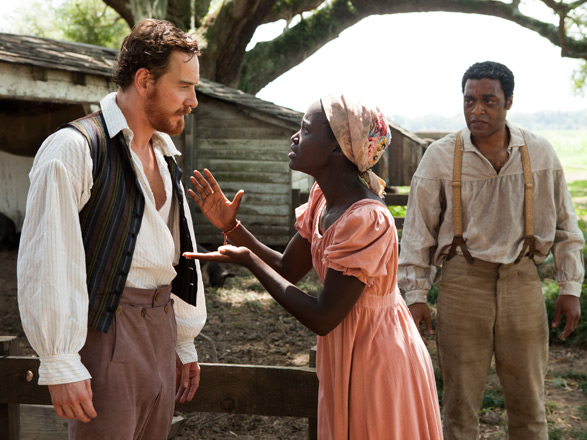 Michael Fassbender, Lupita Nyong'o, and Chiwetel Ejiofor in a still from Fox Searchlight Pictures' 12 Years a Slave.