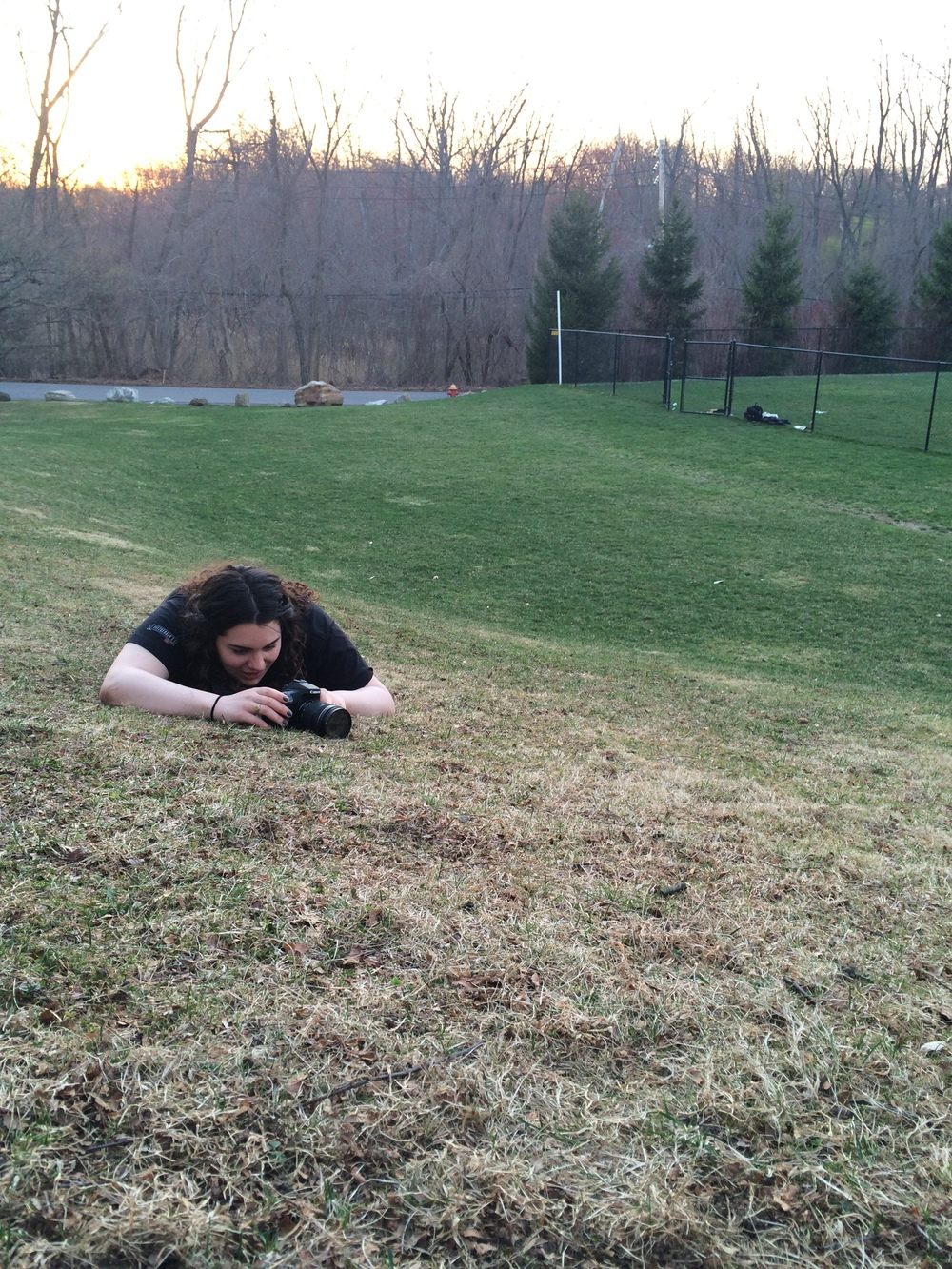Levy lies on the ground to the get the perfect angle for a shot. Photos by Anna Ilina '15