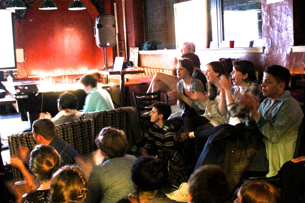 Students applaud the performers at a recent Open Mic in the Black Squirrel.