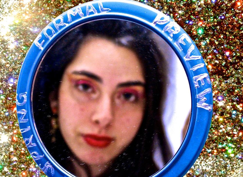 Anna Nemetz '17 models the glitter theme for Ellie Brumbaum '17.