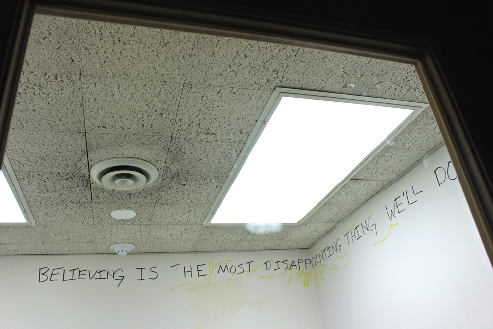 The artist's writing adorns the walls of a library study room