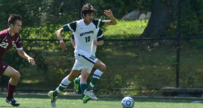 Ishaan Pujari '15 sneaks the ball past opposing defenders.  Photo by Paul Blascovich