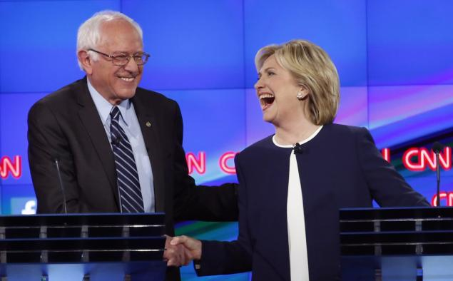 Presidential candidates Bernie Sanders and Hillary Clinton at the first Democratic debate. Photo credit: Lucy Nicholson/Reuters