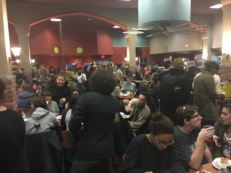 Students crowd bates for midnight breakfast. Photo credit: andrea cantor '17