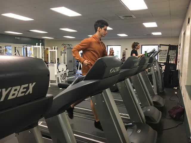 Jasper Soloff running on a treadmill in Campbell Sports Center. Photo credit: Andrea Cantor '17