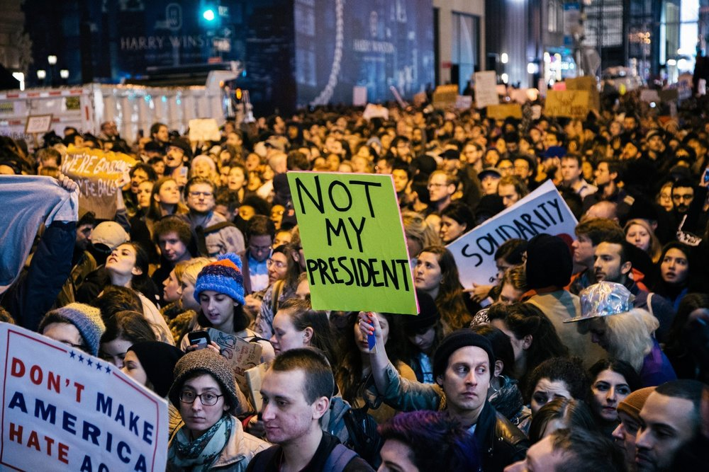 Protestors standing up against the election of Donald Trump in New York City. Photo courtesy of the Los Angeles Times