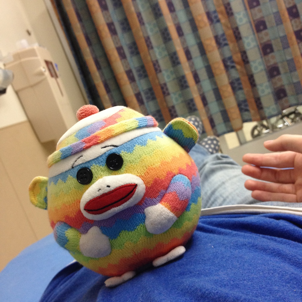 My husband grabbed Rainbowsockmonkeyball out of the car and brought him into the ER, just to cheer me up. It was an adorable gesture -- and it worked. This little ball of colors always makes me smile.