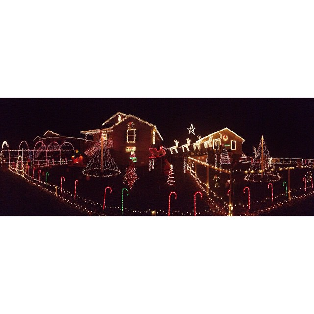 Drove into town to check out this delightful holiday light display, spanning across three houses. Chatted for a bit with the guy that set everything up -- this took him three months! He did a fantastic job. I love holiday lights. 😍 #holidaylights #christmaslights