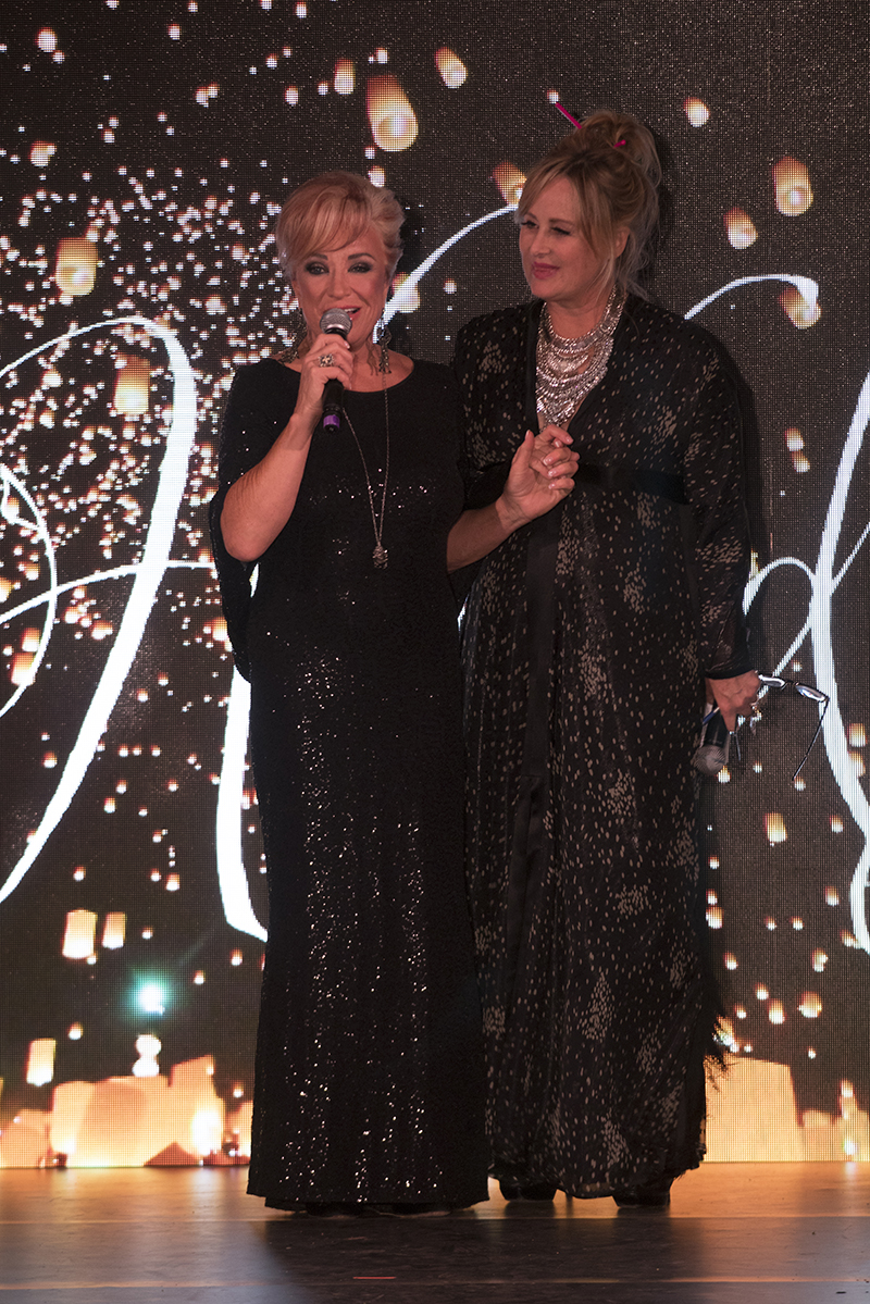 "Country music legend Tanya Tucker and Kelly Stone singing ""Amazing Grace,"" wearing JAKE Photo courtesy of Hands On Studio"