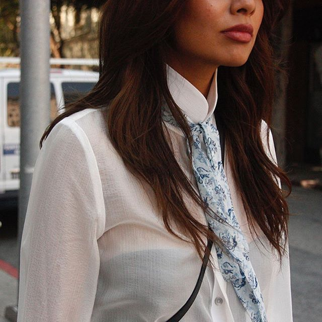 IN ACTION: Our chinoiserie neck tie blouse is your answer to day-to-night style. Shop it online by visiting #linkinbio. #iwearjake #streetstyle #streetwear
