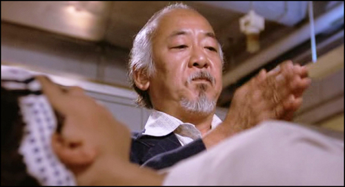 Pat Morita. Be honest, does the  Miyagi-hand-clap  still give you chills?