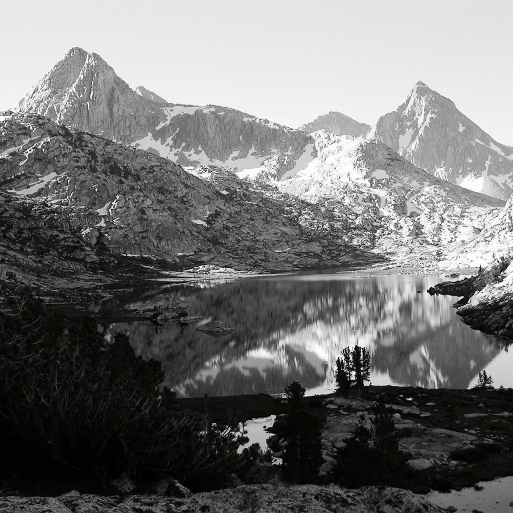 Looking south, across Evolution Lake towards Mt. Spencer and the Goddard Divide , just after sunrise . Sierra Nevada range, California.