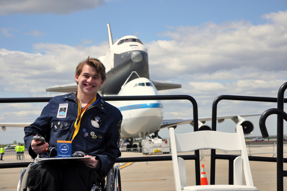 Sawyer Rosenstein in front of the Space Shuttle Enterprise shortly after its landing in New York City. Credit: Joel Rosenstein