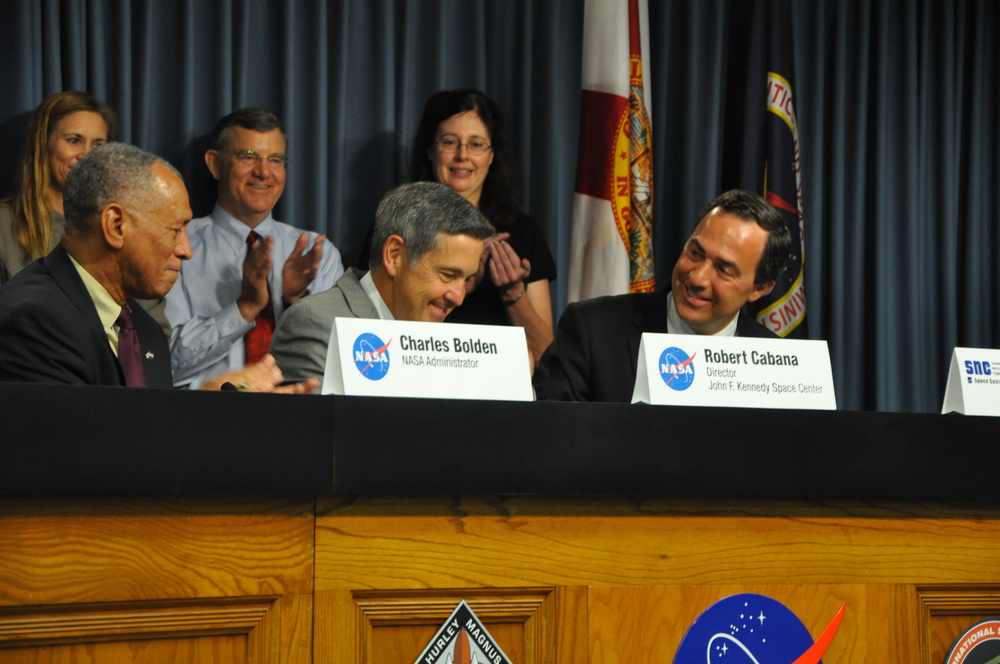 From Left to Right Charlie Bolden, Bob Cabana, and Mark Sirangelo after signing an agreement between Sierra Nevada Corp. and NASA