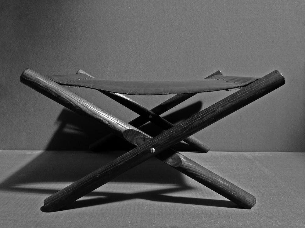 """Wrinkled black leather   Charred oak  12""""H x 22"""" W x 19"""" D"""