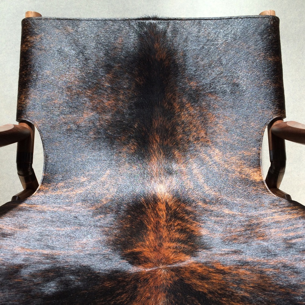"Brown brindle hide Black walnut Raw copper 28""H x 28"" W x 31""D"