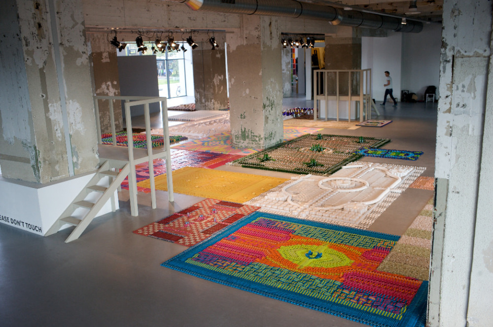 Installation view of a 5 year review of Dutch trio, We Make Carpets. From a distance, you see traditional pattern making, up close you'll be confronted by a critical view of consumer society. It's pretty great to be allured by the beauty and then quietly chastised by the message.