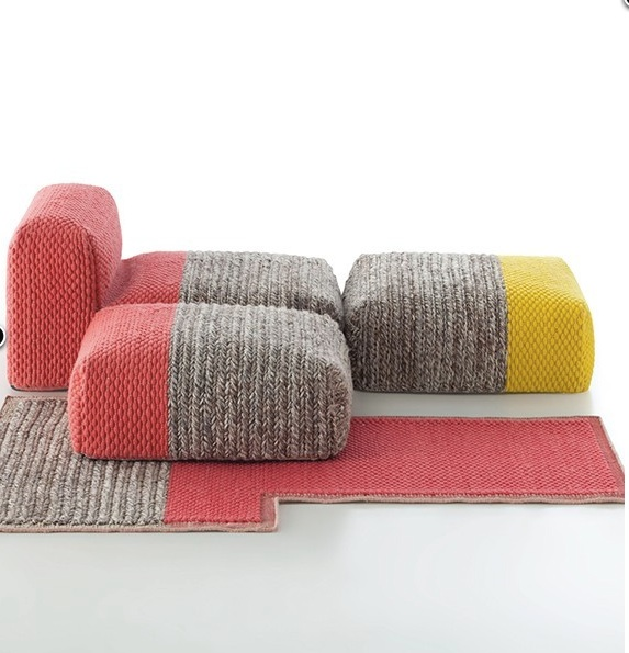 It looks pretty nice to lounge around on these knit modular pieces. Available here for a pretty penny.