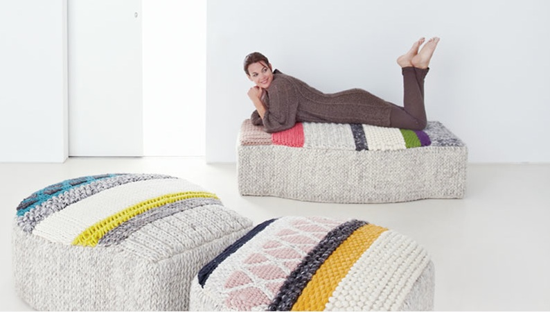 I would take one of these poufs from GAN rugs.