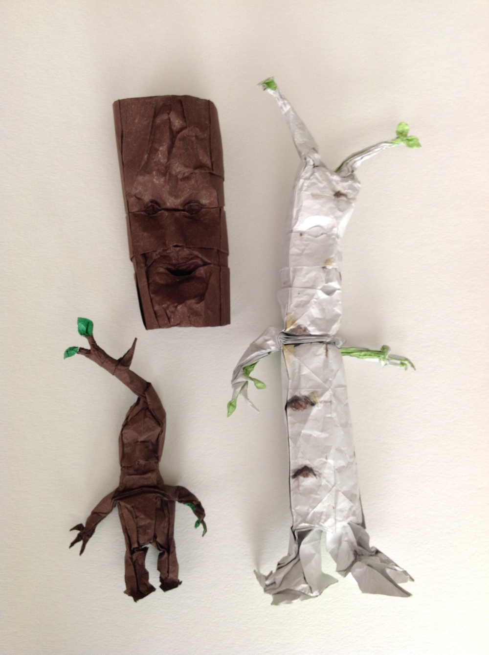 Each of these figures was inspired some of my favorite fictional characters and creatures such as J.R.R. Tolkien's ents, the dynamic emotions of Inside Out, or exotic praying mantids found in nature.     Each study was folded from a single uncut sheet of tissue foil. Designed and folded by Blake Derksen.