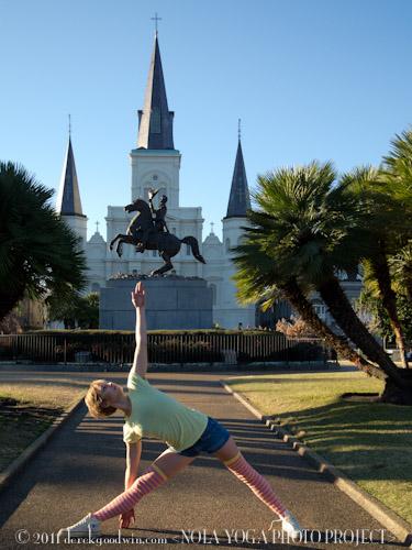 Mary Kuzmovich doing utthita trikonasana in Jefferson Square, New Orleans