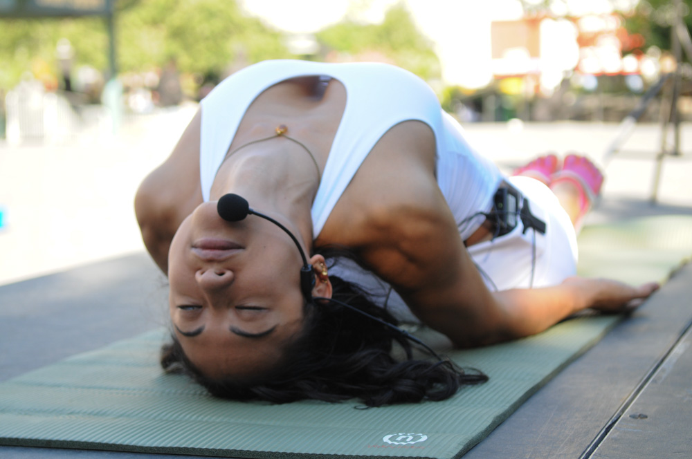Alexandra Voukitchevitch in Union Square Park, demonstrating Matsyasana